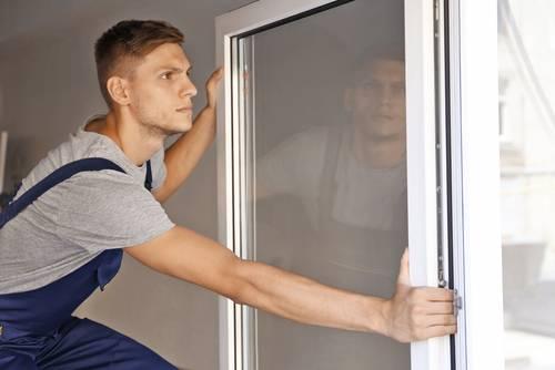 man installing window